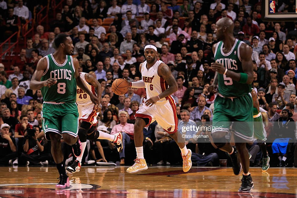 LeBron James #6 of the Miami Heat dribbles the ball as Jeff Green #8 of the Boston Celtics and Kevin Garnett #5 of the Boston Celtics look on at American Airlines Arena on October 30, 2012 in Miami, Florida.