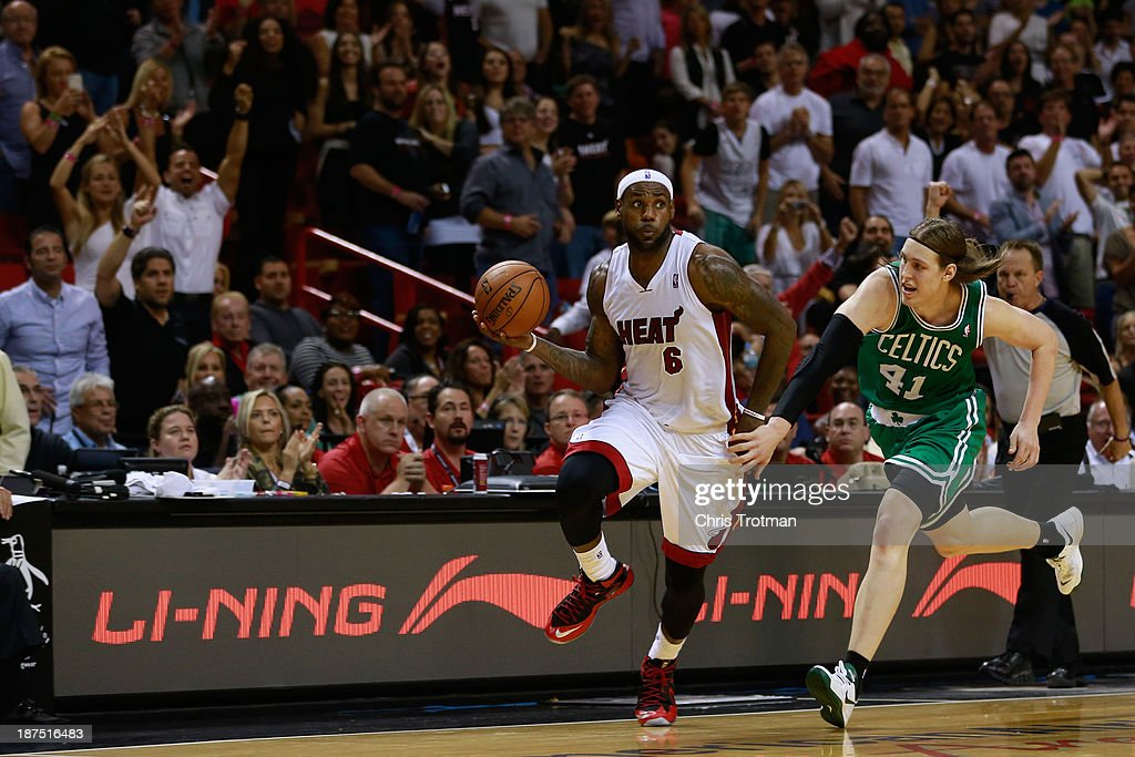 LeBron James #6 of the Miami Heat dribbles the ball under pressure from Kelly Olynyk #41 of the Boston Celtics at American Airlines Arena on November 9, 2013 in Miami, Florida.