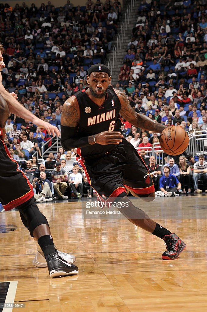LeBron James #6 of the Miami Heat dribbles the ball up the floor against the Orlando Magic during the game on December 31, 2012 at Amway Center in Orlando, Florida.
