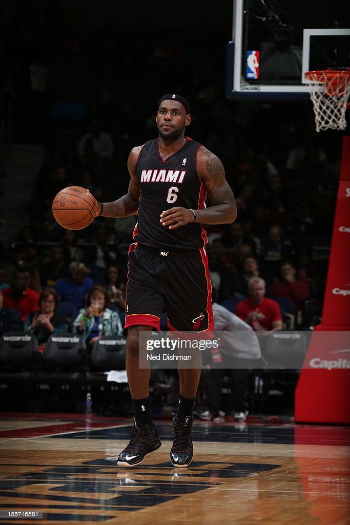 <a gi-track='captionPersonalityLinkClicked' href=/galleries/search?phrase=LeBron+James&family=editorial&specificpeople=201474 ng-click='$event.stopPropagation()'>LeBron James</a> #6 of the Miami Heat dribbles up the court against the Washington Wizards during the pre-season game at the Verizon Center on October 15, 2013 in Washington, DC.