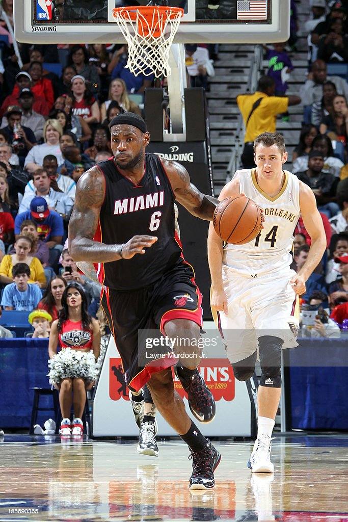 <a gi-track='captionPersonalityLinkClicked' href=/galleries/search?phrase=LeBron+James&family=editorial&specificpeople=201474 ng-click='$event.stopPropagation()'>LeBron James</a> #6 of the Miami Heat dribbles up the floor against the New Orleans Pelicans during an NBA preseason game on October 23,2013 at the New Orleans Arena in New Orleans, Louisiana.