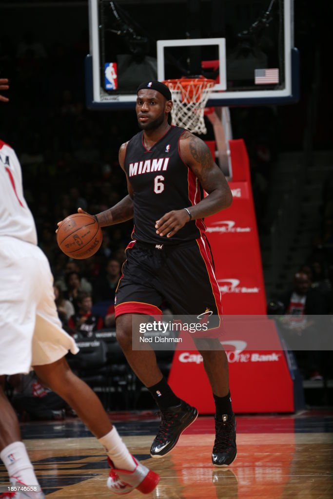 <a gi-track='captionPersonalityLinkClicked' href=/galleries/search?phrase=LeBron+James&family=editorial&specificpeople=201474 ng-click='$event.stopPropagation()'>LeBron James</a> #6 of the Miami Heat dribbles up the floor against the Washington Wizards during the pre-season game at the Verizon Center on October 15, 2013 in Washington, DC.