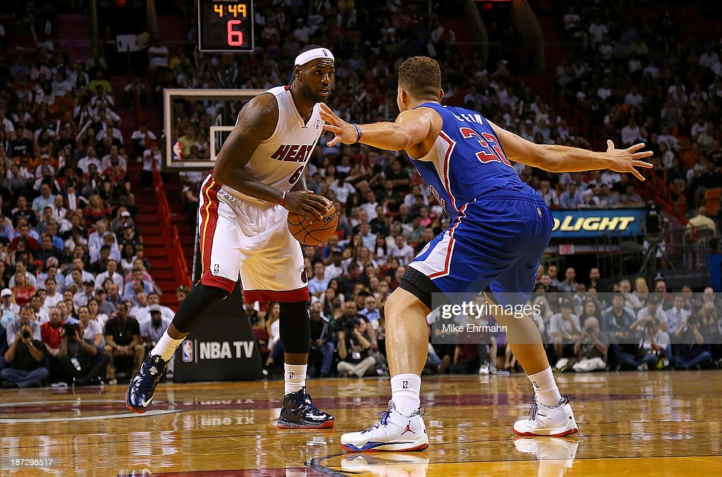 <a gi-track='captionPersonalityLinkClicked' href=/galleries/search?phrase=LeBron+James&family=editorial&specificpeople=201474 ng-click='$event.stopPropagation()'>LeBron James</a> #6 of the Miami Heat drives against <a gi-track='captionPersonalityLinkClicked' href=/galleries/search?phrase=Blake+Griffin+-+Basketball+Player&family=editorial&specificpeople=4216010 ng-click='$event.stopPropagation()'>Blake Griffin</a> #32 of the Los Angeles Clippers during a game at AmericanAirlines Arena on November 7, 2013 in Miami, Florida.