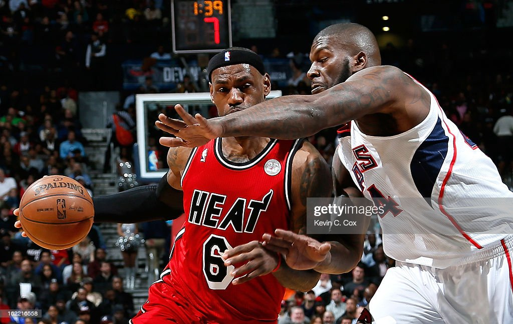 LeBron James #6 of the Miami Heat drives against Ivan Johnson #44 of the Atlanta Hawks at Philips Arena on February 20, 2013 in Atlanta, Georgia.