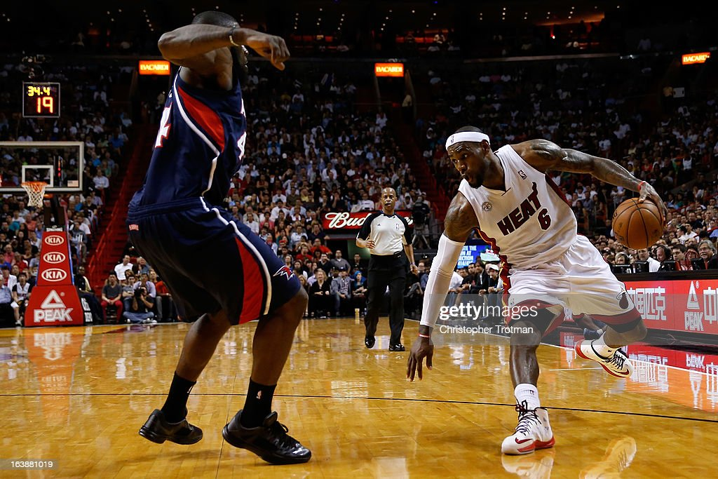 LeBron James #6 of the Miami Heat drives against Ivan Johnson #44 of the Atlanta Hawks at American Airlines Arena on March 12, 2013 in Miami, Florida.