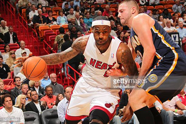LeBron James of the Miami Heat drives against Josh McRoberts of the Indiana Pacers on November 22 2010 at American Airlines Arena in Miami Florida...