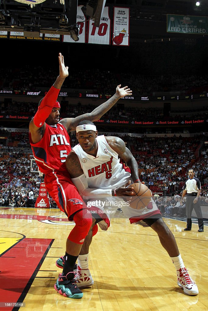 LeBron James #6 of the Miami Heat drives against Josh Smith #5 of the Atlanta Hawks during a game between the Atlanta Hawks and the Miami Heat on December 10, 2012 at American Airlines Arena in Miami, Florida.