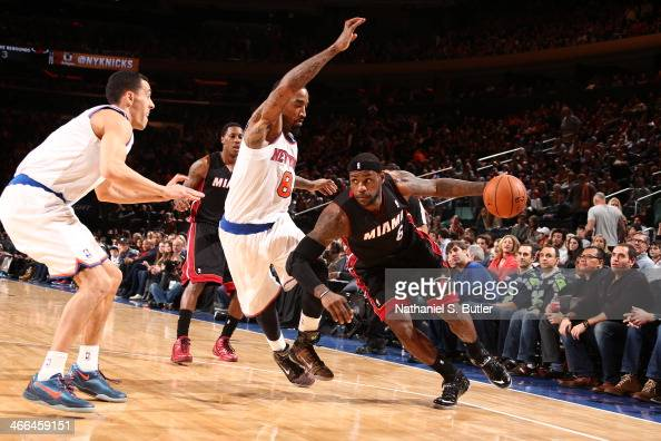 LeBron James of the Miami Heat drives against JR Smith of the New York Knicks during a game at Madison Square Garden in New York City on February 01...