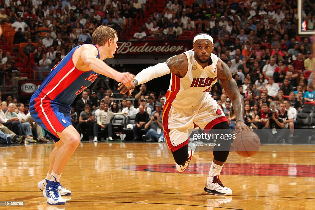 LeBron James #6 of the Miami Heat drives against Kyle Singler #25 of the Detroit Pistons on March 22, 2013 at American Airlines Arena in Miami, Florida.