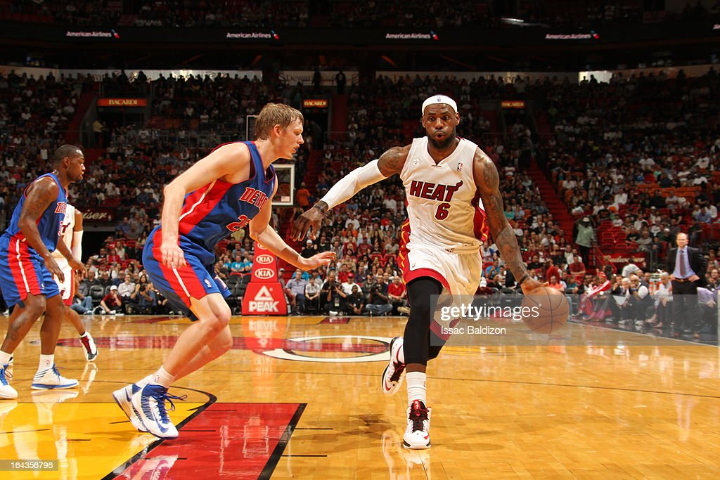 <a gi-track='captionPersonalityLinkClicked' href=/galleries/search?phrase=LeBron+James&family=editorial&specificpeople=201474 ng-click='$event.stopPropagation()'>LeBron James</a> #6 of the Miami Heat drives against <a gi-track='captionPersonalityLinkClicked' href=/galleries/search?phrase=Kyle+Singler&family=editorial&specificpeople=4216029 ng-click='$event.stopPropagation()'>Kyle Singler</a> #25 of the Detroit Pistons on March 22, 2013 at American Airlines Arena in Miami, Florida.