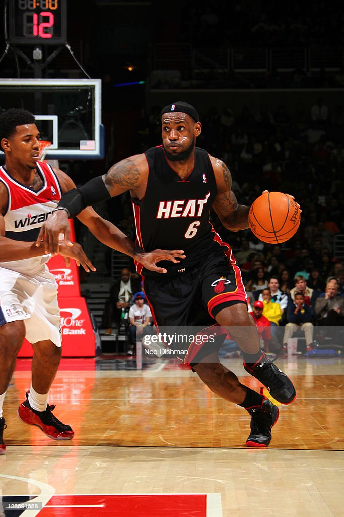 <a gi-track='captionPersonalityLinkClicked' href=/galleries/search?phrase=LeBron+James&family=editorial&specificpeople=201474 ng-click='$event.stopPropagation()'>LeBron James</a> #6 of the Miami Heat drives against Nick Young #1 of the Washington Wizards during the game at the Verizon Center on February 10, 2012 in Washington, DC.