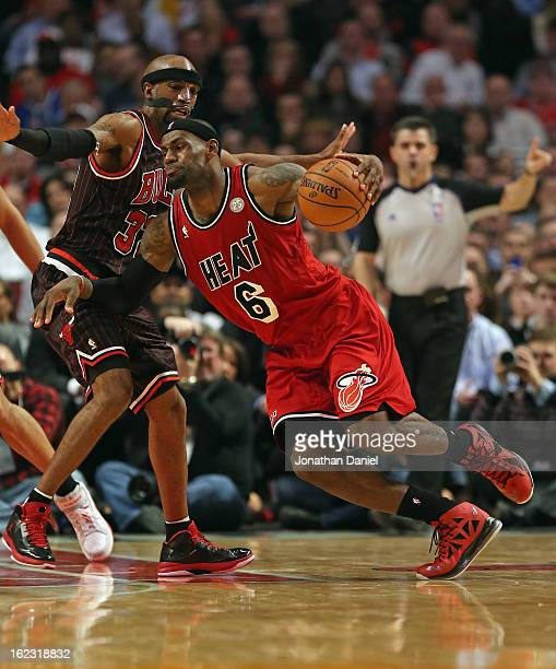 LeBron James of the Miami Heat drives against Richard Hamilton of the Chicago Bulls at the United Center on February 21 2013 in Chicago Illinois The...