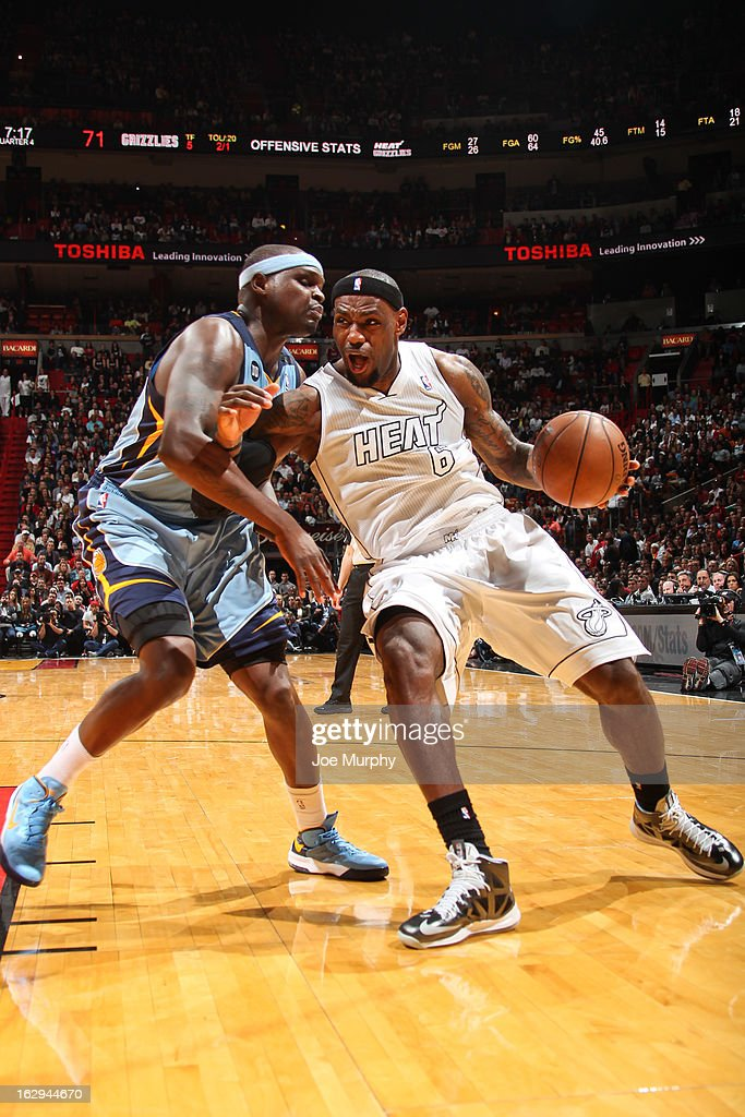 LeBron James #6 of the Miami Heat drives against Zach Randolph #50 of the Memphis Grizzlies on March 1, 2013 at American Airlines Arena in Miami, Florida.