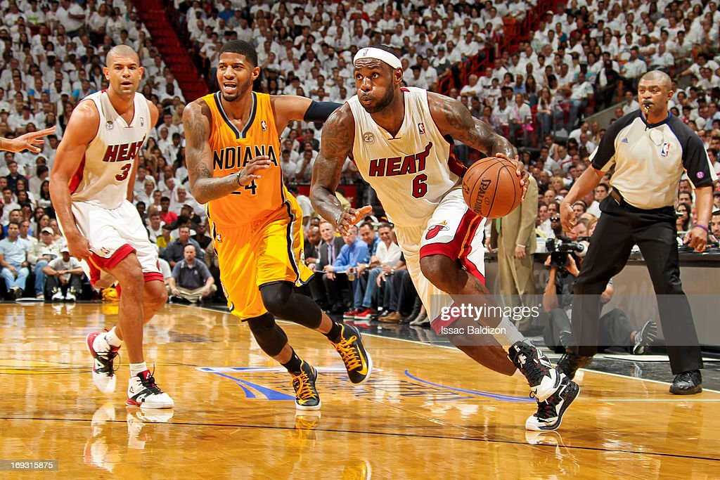 LeBron James #6 of the Miami Heat drives ahead of Paul George #24 of the Indiana Pacers in Game One of the Eastern Conference Finals during the 2013 NBA Playoffs on May 22, 2013 at American Airlines Arena in Miami, Florida.