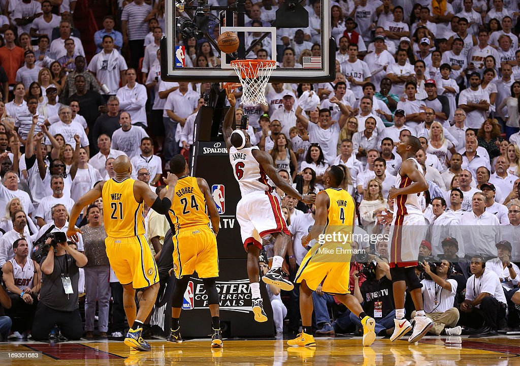 <a gi-track='captionPersonalityLinkClicked' href=/galleries/search?phrase=LeBron+James&family=editorial&specificpeople=201474 ng-click='$event.stopPropagation()'>LeBron James</a> #6 of the Miami Heat drives and makes the game winning basket in overtime against the Indiana Pacers during Game One of the Eastern Conference Finals at AmericanAirlines Arena on May 22, 2013 in Miami, Florida.