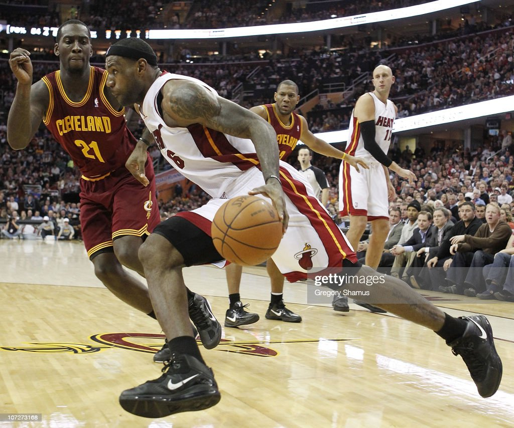 <a gi-track='captionPersonalityLinkClicked' href=/galleries/search?phrase=LeBron+James&family=editorial&specificpeople=201474 ng-click='$event.stopPropagation()'>LeBron James</a> #6 of the Miami Heat drives around <a gi-track='captionPersonalityLinkClicked' href=/galleries/search?phrase=J.J.+Hickson&family=editorial&specificpeople=4226173 ng-click='$event.stopPropagation()'>J.J. Hickson</a> #21 of the Cleveland Cavaliers at Quicken Loans Arena on December 2, 2010 in Cleveland, Ohio.