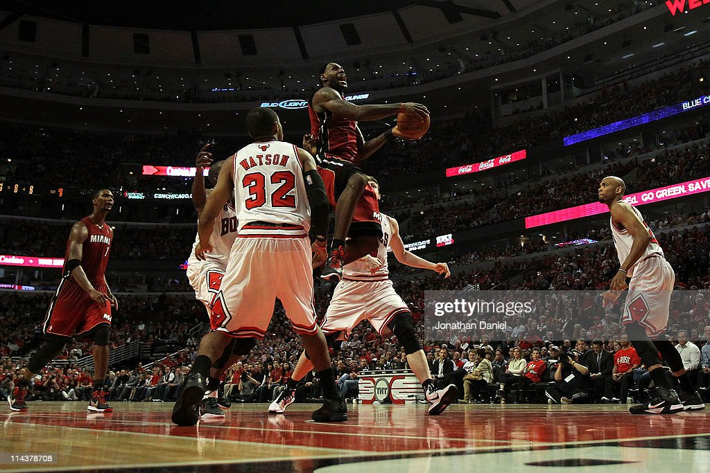 LeBron James of the Miami Heat drives for a shot attempt against CJ Watson of the Chicago Bulls in Game Two of the Eastern Conference Finals during...
