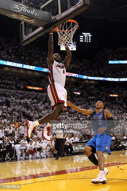 LeBron James of the Miami Heat drives for a shot attempt against Shawn Marion of the Dallas Mavericks in Game Two of the 2011 NBA Finals at American...