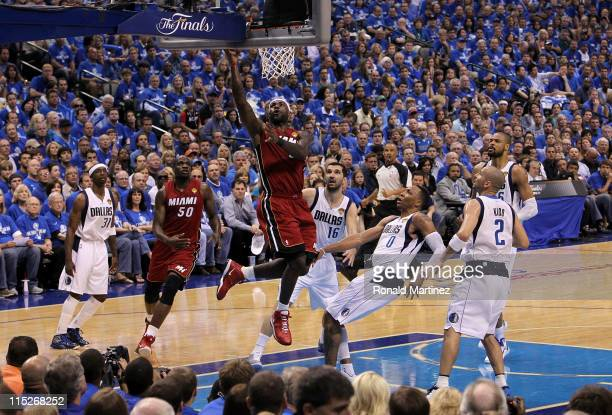 LeBron James of the Miami Heat drives for a shot attempt against Shawn Marion of the Dallas Mavericks in Game Three of the 2011 NBA Finals at...