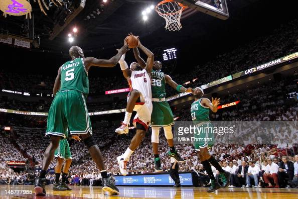 LeBron James of the Miami Heat drives for a shot attempt in the second half against Kevin Garnett and Mickael Pietrus of the Boston Celtics in Game...