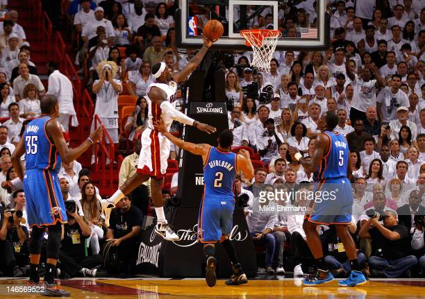 LeBron James of the Miami Heat drives for a shot attempt in the second half against Thabo Sefolosha of the Oklahoma City Thunder in Game Four of the...