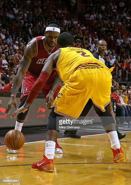LeBron James of the Miami Heat drives on Kyrie Irving of the Cleveland Cavaliers during a game at American Airlines Arena on December 14 2013 in...