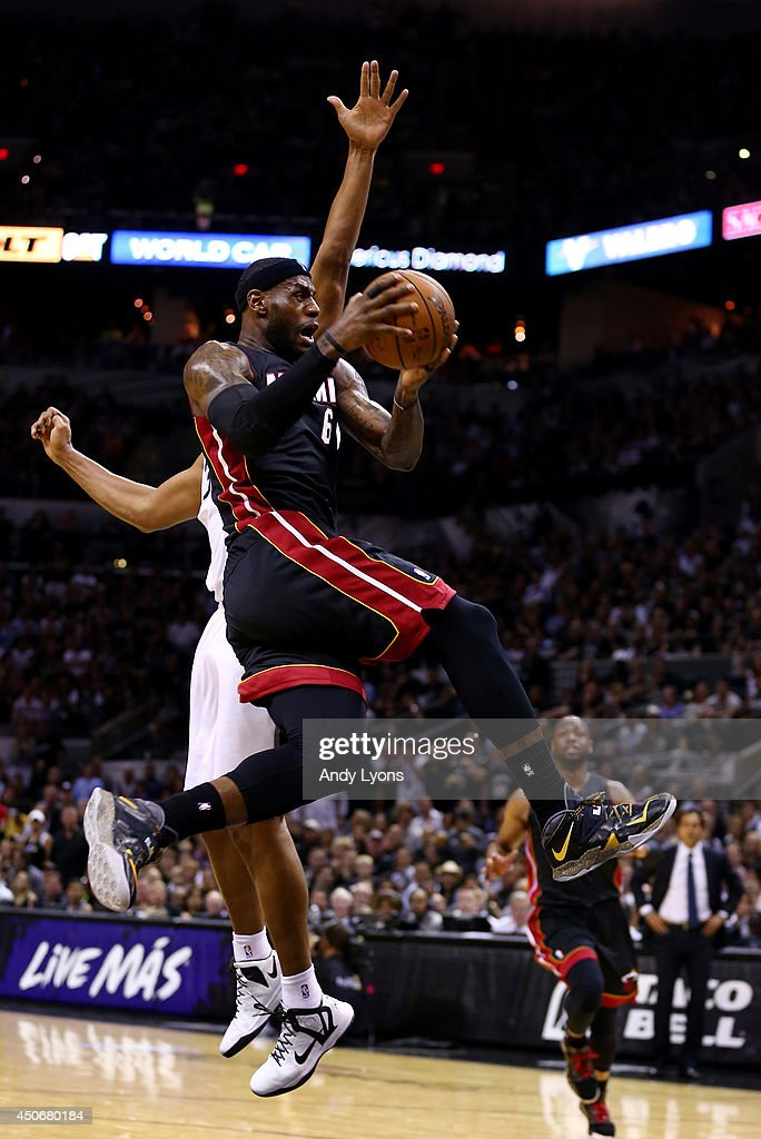 <a gi-track='captionPersonalityLinkClicked' href=/galleries/search?phrase=LeBron+James&family=editorial&specificpeople=201474 ng-click='$event.stopPropagation()'>LeBron James</a> #6 of the Miami Heat drives to the basket against <a gi-track='captionPersonalityLinkClicked' href=/galleries/search?phrase=Boris+Diaw&family=editorial&specificpeople=201505 ng-click='$event.stopPropagation()'>Boris Diaw</a> #33 of the San Antonio Spurs during Game Five of the 2014 NBA Finals at the AT&T Center on June 15, 2014 in San Antonio, Texas.