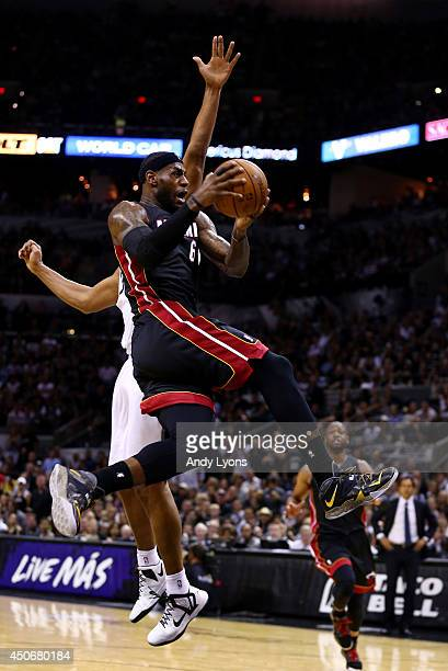 LeBron James of the Miami Heat drives to the basket against Boris Diaw of the San Antonio Spurs during Game Five of the 2014 NBA Finals at the ATT...