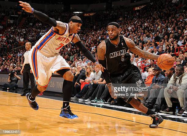 LeBron James of the Miami Heat drives to the basket against Carmelo Anthony of the New York Knicks during the game on February 23 2012 at American...