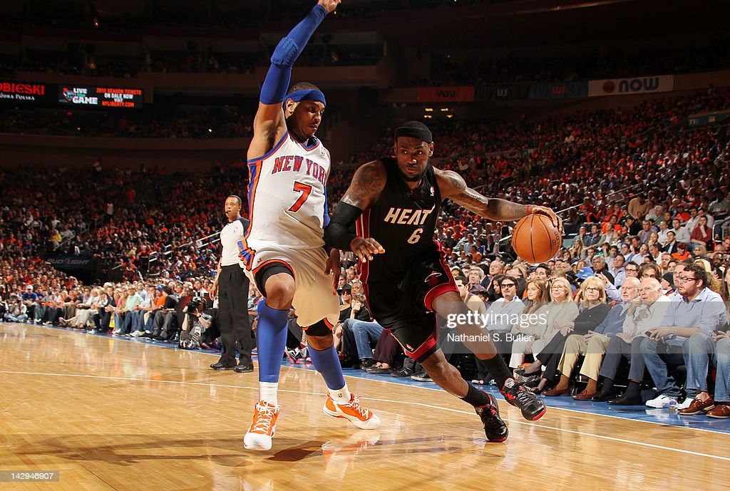 <a gi-track='captionPersonalityLinkClicked' href=/galleries/search?phrase=LeBron+James&family=editorial&specificpeople=201474 ng-click='$event.stopPropagation()'>LeBron James</a> #6 of the Miami Heat drives to the basket against <a gi-track='captionPersonalityLinkClicked' href=/galleries/search?phrase=Carmelo+Anthony&family=editorial&specificpeople=201494 ng-click='$event.stopPropagation()'>Carmelo Anthony</a> #7 of the New York Knicks during the game on April 15, 2012 at Madison Square Garden in New York City.