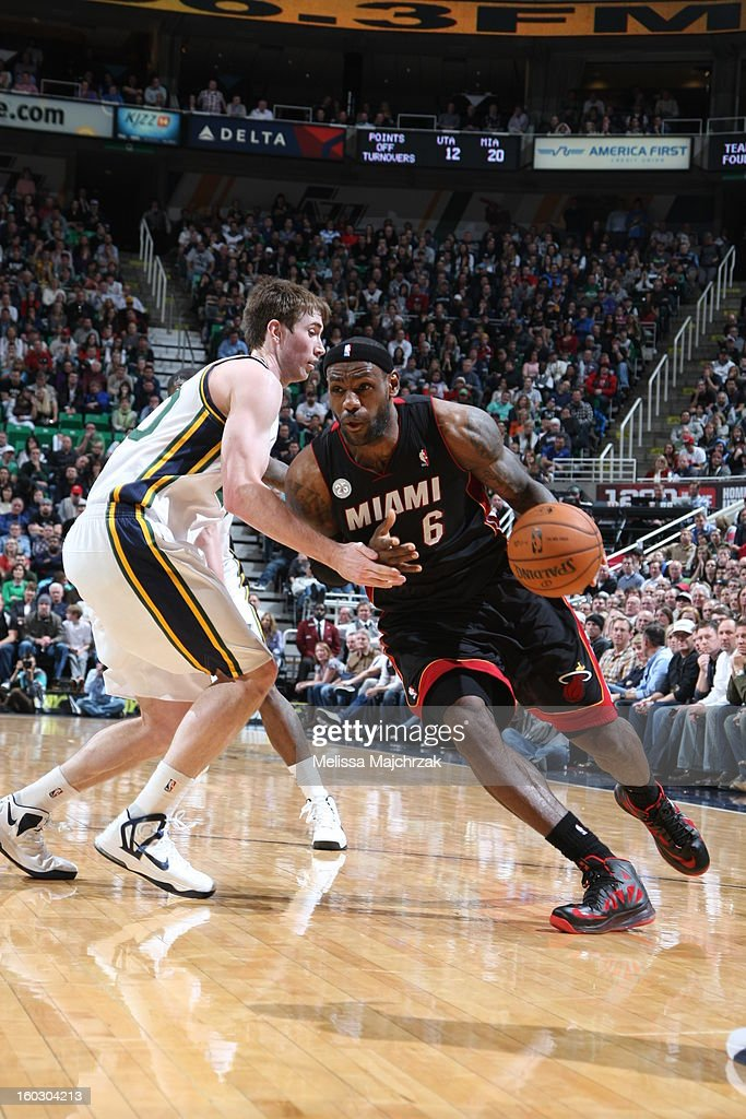 <a gi-track='captionPersonalityLinkClicked' href=/galleries/search?phrase=LeBron+James&family=editorial&specificpeople=201474 ng-click='$event.stopPropagation()'>LeBron James</a> #6 of the Miami Heat drives to the basket against <a gi-track='captionPersonalityLinkClicked' href=/galleries/search?phrase=Gordon+Hayward&family=editorial&specificpeople=5767271 ng-click='$event.stopPropagation()'>Gordon Hayward</a> #20 of the Utah Jazz at Energy Solutions Arena on January 14, 2013 in Salt Lake City, Utah.