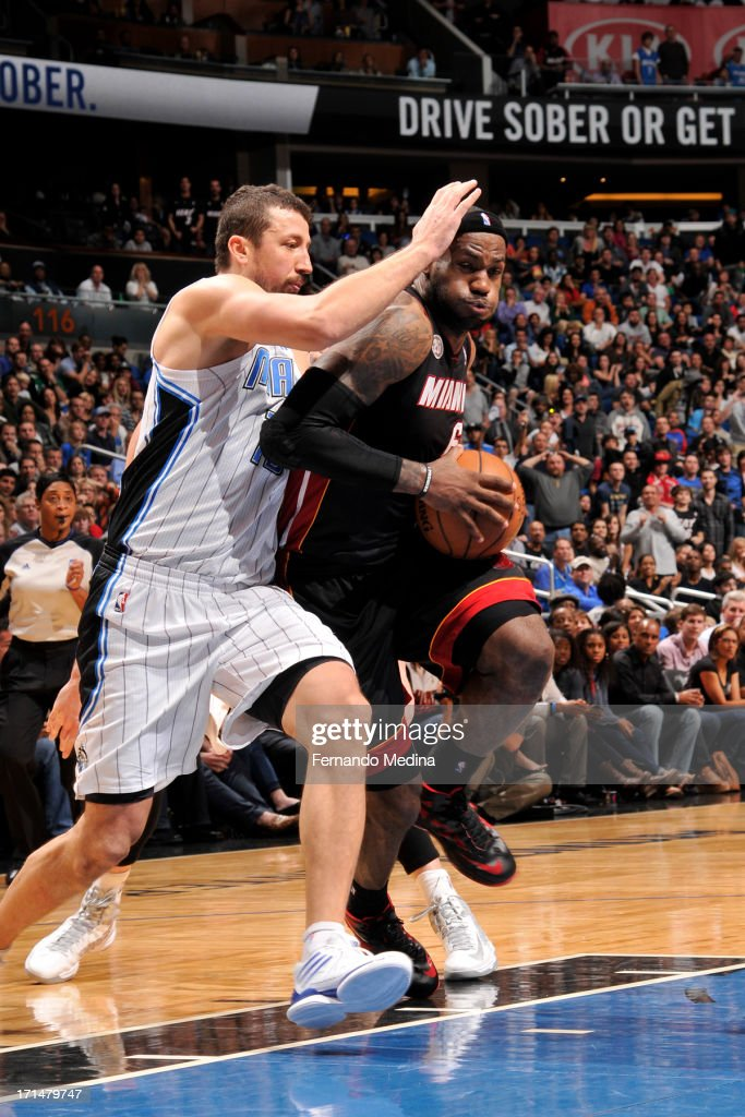 LeBron James #6 of the Miami Heat drives to the basket against Hedo Turkoglu #15 of the Orlando Magic on December 31, 2012 at Amway Center in Orlando, Florida.