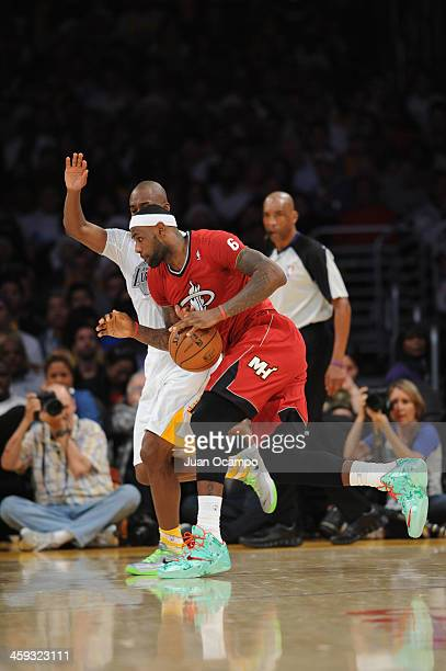 LeBron James of the Miami Heat drives to the basket against Jodie Meeks of the Los Angeles Lakers at STAPLES Center on December 25 2013 in Los...