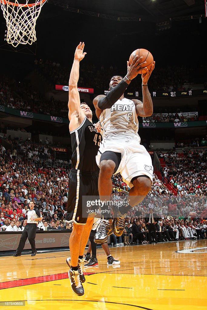 LeBron James #6 of the Miami Heat drives to the basket against Kris Humphries #43 of the Brooklyn Nets on December 1, 2012 at American Airlines Arena in Miami, Florida.
