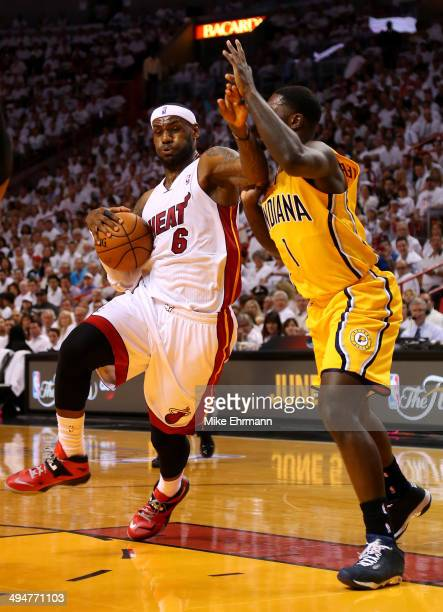 LeBron James of the Miami Heat drives to the basket against Lance Stephenson of the Indiana Pacers during Game Six of the Eastern Conference Finals...