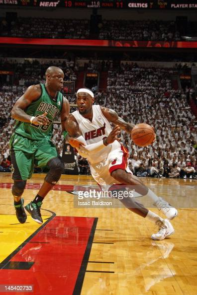 LeBron James of the Miami Heat drives to the basket against Mickael Pietrus of the Boston Celtics in Game One of the Eastern Conference Finals during...