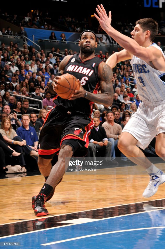 LeBron James #6 of the Miami Heat drives to the basket against Nikola Vucevic #9 of the Orlando Magic on December 31, 2012 at Amway Center in Orlando, Florida.