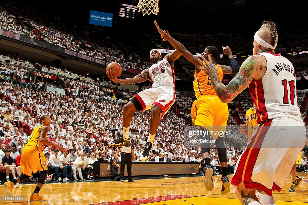 LeBron James #6 of the Miami Heat drives to the basket against Roy Hibbert #55 of the Indiana Pacers in Game One of the Eastern Conference Finals during the 2013 NBA Playoffs on May 22, 2013 at American Airlines Arena in Miami, Florida.