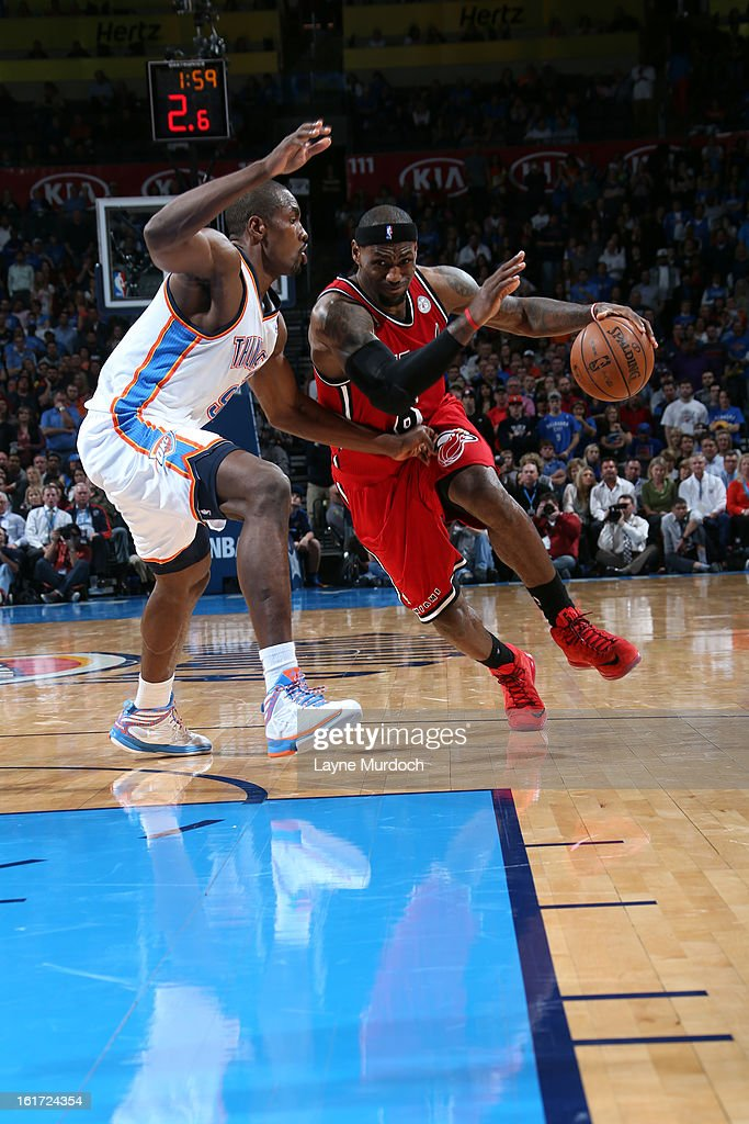 <a gi-track='captionPersonalityLinkClicked' href=/galleries/search?phrase=LeBron+James&family=editorial&specificpeople=201474 ng-click='$event.stopPropagation()'>LeBron James</a> #6 of the Miami Heat drives to the basket against the Oklahoma City Thunder during an NBA game on February 14, 2013 at the Chesapeake Energy Arena in Oklahoma City, Oklahoma.