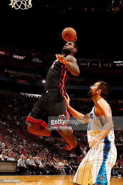 LeBron James of the Miami Heat drives to the basket against the New Orleans Hornets on October 26 2012 at American Airlines Arena in Miami Florida...
