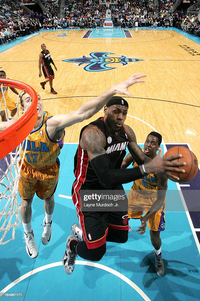 <a gi-track='captionPersonalityLinkClicked' href=/galleries/search?phrase=LeBron+James&family=editorial&specificpeople=201474 ng-click='$event.stopPropagation()'>LeBron James</a> #6 of the Miami Heat drives to the basket against the New Orleans Hornets on March 29, 2013 at the New Orleans Arena in New Orleans, Louisiana.
