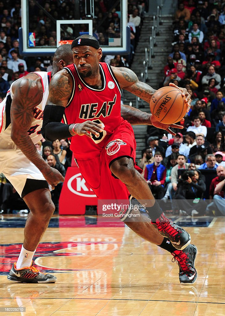 <a gi-track='captionPersonalityLinkClicked' href=/galleries/search?phrase=LeBron+James&family=editorial&specificpeople=201474 ng-click='$event.stopPropagation()'>LeBron James</a> #6 of the Miami Heat drives to the basket against the Atlanta Hawks on February 20, 2013 at Philips Arena in Atlanta, Georgia.