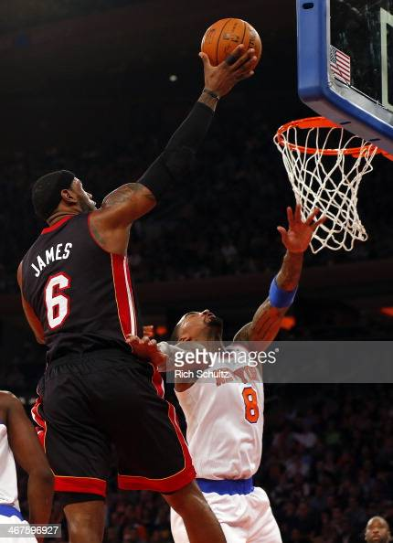 LeBron James of the Miami Heat drives to the basket as JR Smith of the New York Knicks defends at Madison Square Garden on February 1 2014 in New...