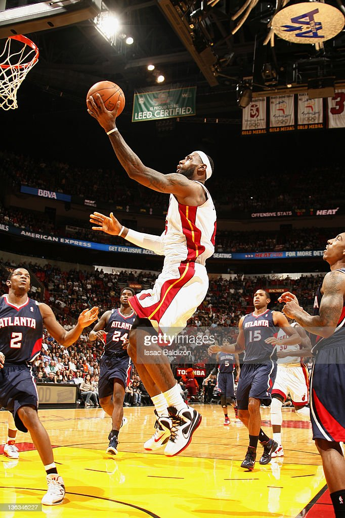 <a gi-track='captionPersonalityLinkClicked' href=/galleries/search?phrase=LeBron+James&family=editorial&specificpeople=201474 ng-click='$event.stopPropagation()'>LeBron James</a> #6 of the Miami Heat drives to the basket during the first quarter against the Atlanta Hawks on January 2, 2012 at American Airlines Arena in Miami, Florida.