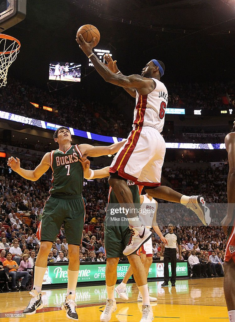 <a gi-track='captionPersonalityLinkClicked' href=/galleries/search?phrase=LeBron+James&family=editorial&specificpeople=201474 ng-click='$event.stopPropagation()'>LeBron James</a> #6 of the Miami Heat drives to the rim over <a gi-track='captionPersonalityLinkClicked' href=/galleries/search?phrase=Ersan+Ilyasova&family=editorial&specificpeople=557070 ng-click='$event.stopPropagation()'>Ersan Ilyasova</a> #7 of the Milwaukee Bucks during a game at American Airlines Arena on January 4, 2011 in Miami, Florida.