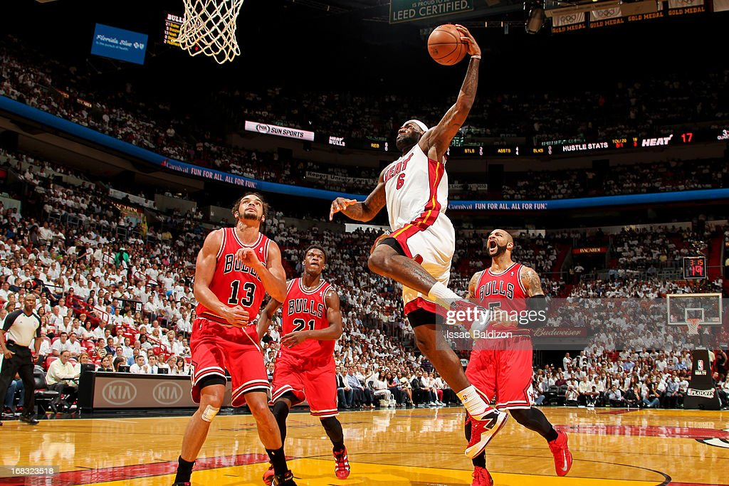 <a gi-track='captionPersonalityLinkClicked' href=/galleries/search?phrase=LeBron+James&family=editorial&specificpeople=201474 ng-click='$event.stopPropagation()'>LeBron James</a> #6 of the Miami Heat dunks against <a gi-track='captionPersonalityLinkClicked' href=/galleries/search?phrase=Joakim+Noah&family=editorial&specificpeople=699038 ng-click='$event.stopPropagation()'>Joakim Noah</a> #13 of the Chicago Bulls in Game Two of the Eastern Conference Semifinals during the 2013 NBA Playoffs on May 8, 2013 at American Airlines Arena in Miami, Florida.