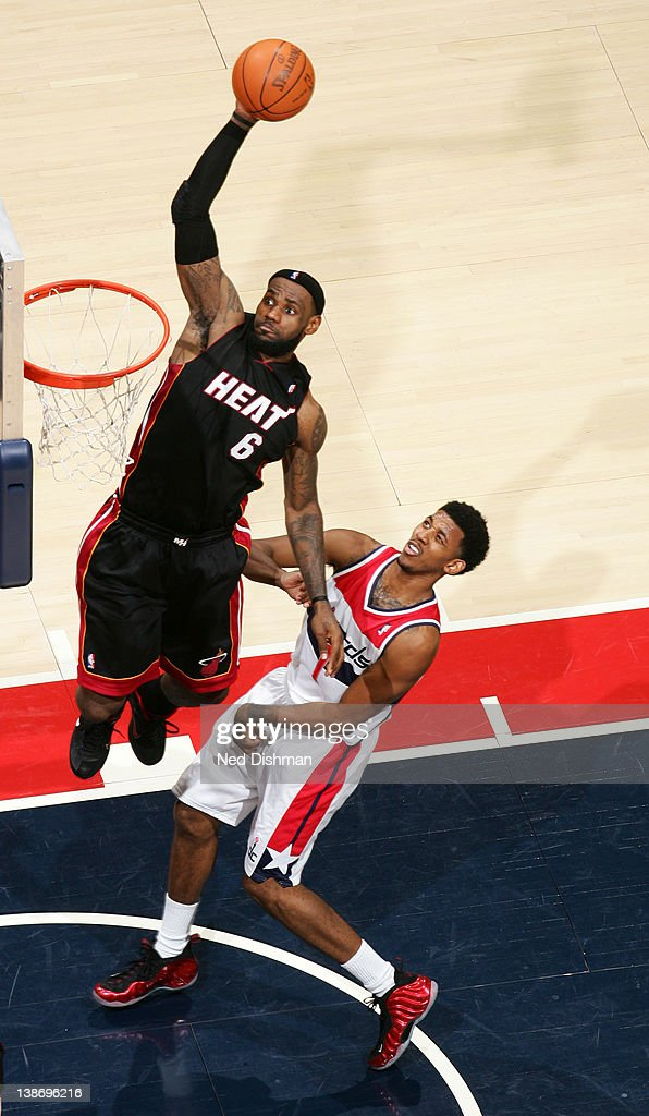 <a gi-track='captionPersonalityLinkClicked' href=/galleries/search?phrase=LeBron+James&family=editorial&specificpeople=201474 ng-click='$event.stopPropagation()'>LeBron James</a> #6 of the Miami Heat dunks against Nick Young #1 of the Washington Wizards during the game at the Verizon Center on February 10, 2012 in Washington, DC.