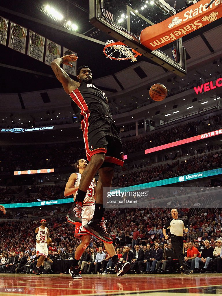 <a gi-track='captionPersonalityLinkClicked' href=/galleries/search?phrase=LeBron+James&family=editorial&specificpeople=201474 ng-click='$event.stopPropagation()'>LeBron James</a> #6 of the Miami Heat dunks against the Chicago Bulls in Game Four of the Eastern Conference Semifinals during the 2013 NBA Playoffs at the United Center on May 13, 2013 in Chicago, Illinois.
