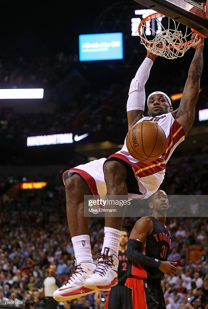 <a gi-track='captionPersonalityLinkClicked' href=/galleries/search?phrase=LeBron+James&family=editorial&specificpeople=201474 ng-click='$event.stopPropagation()'>LeBron James</a> #6 of the Miami Heat dunks during a game against the Toronto Raptors at American Airlines Arena on January 23, 2013 in Miami, Florida.