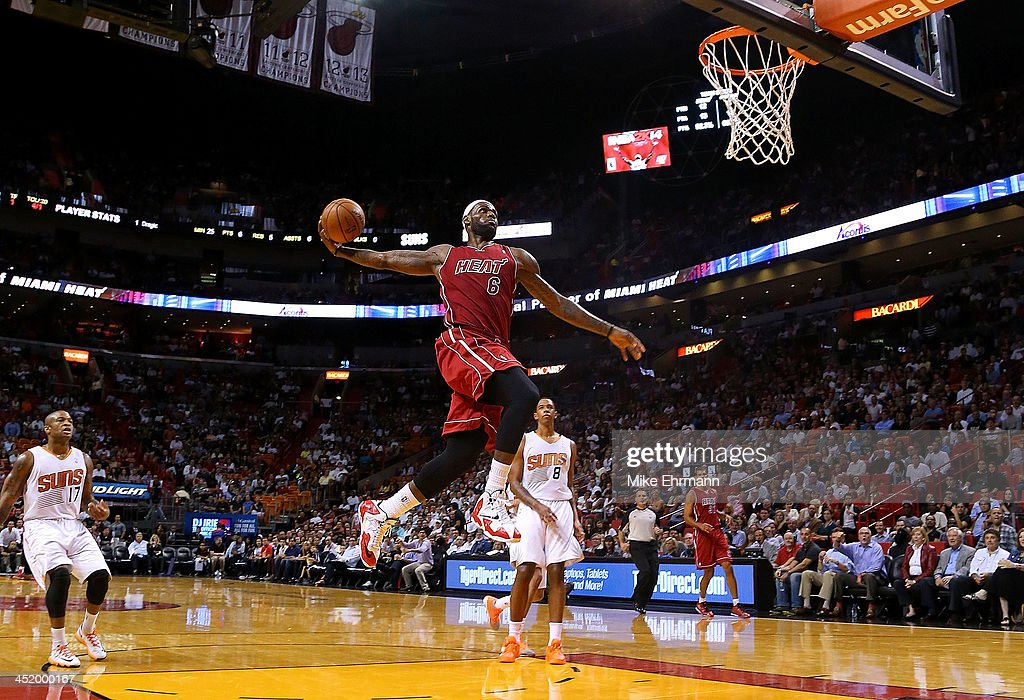 LeBron James of the Miami Heat dunks during a game against the Phoenix Suns at American Airlines Arena on November 25 2013 in Miami Florida NOTE TO...